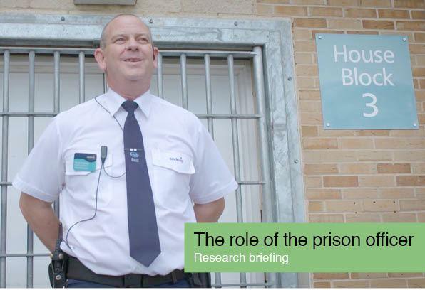 prison officer in front of prison gate