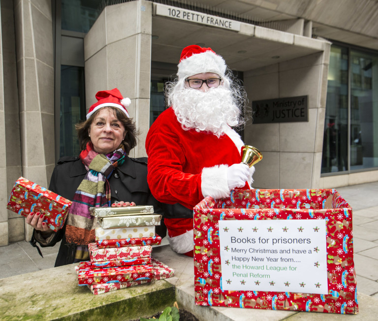 Santa and Frances Crook, chief executive of The Howard League, along with English PEN deliver books for prisoners to the Ministry of Justice HQ, central London.