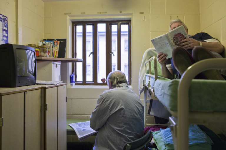 Two men read while sharing a cell in Littlehey prison