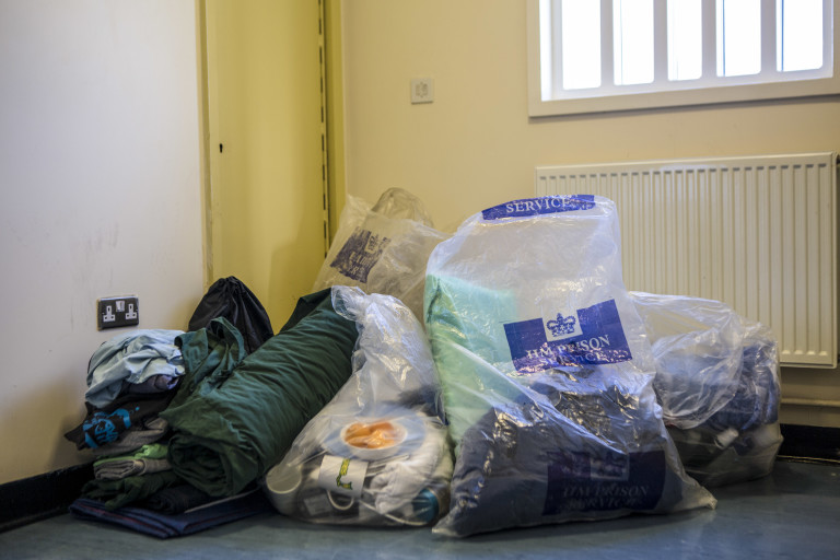 Bags containing a prisoner's belongings are piled in Portland prison
