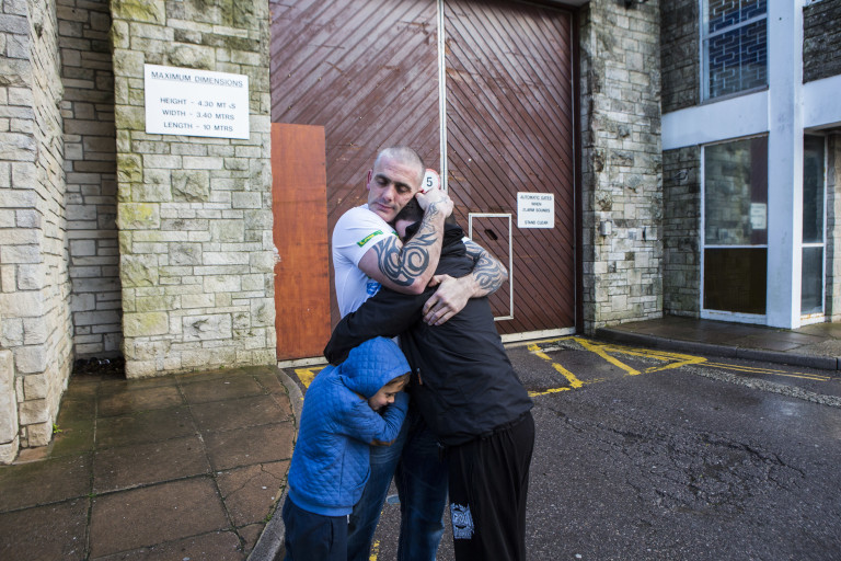 A man meets his family after being released from Portland prison