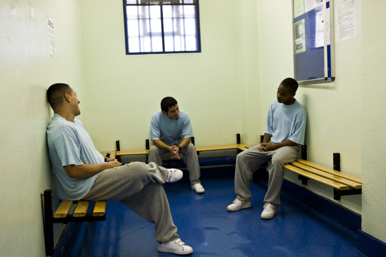 Prisoners sit in the arrivals area in Wandsworth prison